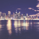 Manhattan skyline reflected in East River at night, NYC - PhotoDune Item for Sale
