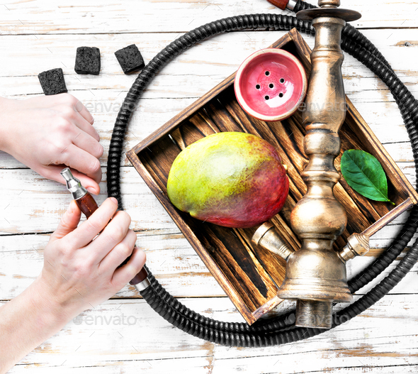 Asian tobacco hookah with mango aroma - Stock Photo - Images