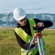 Surveyor Engineer Is Measuring Level on Construction Site - VideoHive Item for Sale