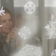 Mother and Son Decorate Windows with Fake Snow - VideoHive Item for Sale