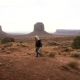 Woman Walking in Monument Valley with Red Rocks Overview. - VideoHive Item for Sale