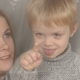 Portrait of Mom and Son Through Window in Winter - VideoHive Item for Sale