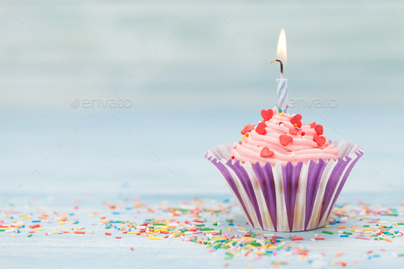 Sweet cupcake with candle - Stock Photo - Images