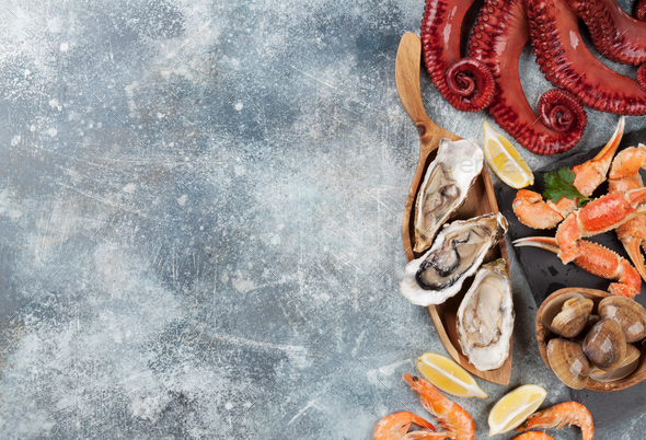 Seafood. Octopus, oysters, lobster, shrimps - Stock Photo - Images