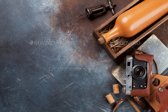 Wine bottle in box and vintage camera - Stock Photo - Images