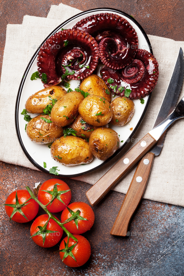 Grilled octopus with small potatoes - Stock Photo - Images