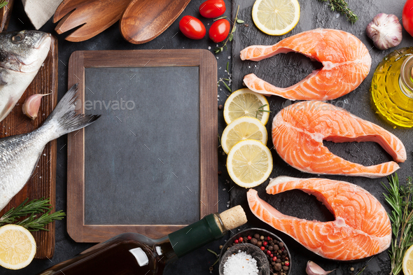Raw salmon fish fillet and dorado - Stock Photo - Images