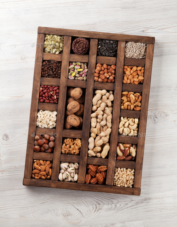 Various nuts in wooden box - Stock Photo - Images
