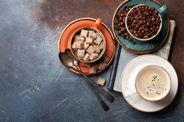 Coffee cups, beans and sugar - Stock Photo - Images