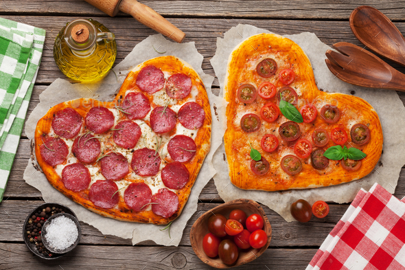 Heart shaped pizza with tomatoes and mozzarella and pepperoni - Stock Photo - Images