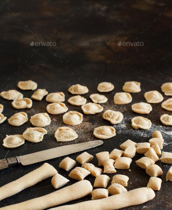 Making whole wheat flour pasta orecchiette - Stock Photo - Images