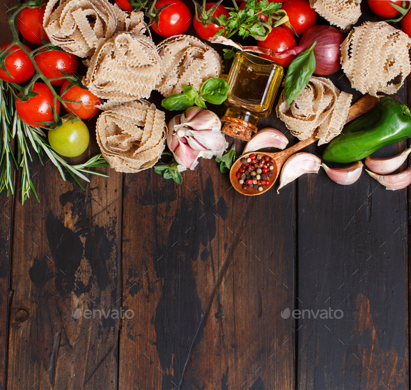 Whole wheat pasta tagliatelle, vegetables and herbs - Stock Photo - Images