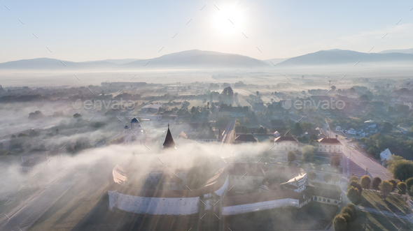 sunrise in Prejmer village. Brasov, Romania - Stock Photo - Images