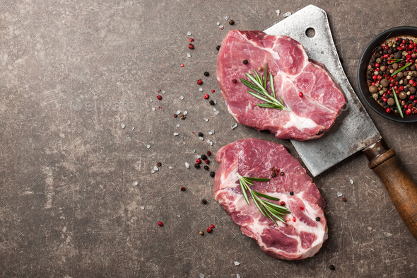 Raw pork steaks with rosemary and spices - Stock Photo - Images