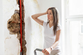 Woman looking at damage after a water pipe leak - PhotoDune Item for Sale