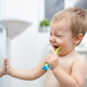 Adorable child learing how to brush his teeth - PhotoDune Item for Sale