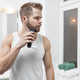 Handsome bearded man trimming his beard with a trimmer - PhotoDune Item for Sale