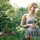 Pregnant Young Woman Smelling Flowers in Garden - VideoHive Item for Sale