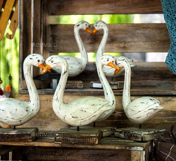 Traditional hand made wooden geese - Stock Photo - Images