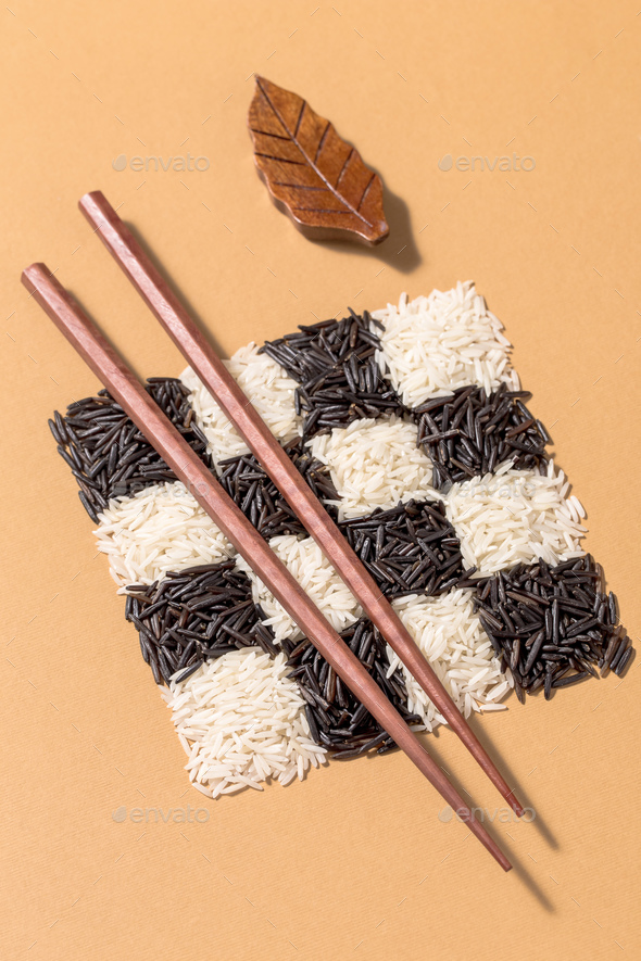 Black and white rice in a checkerboard pattern - Stock Photo - Images