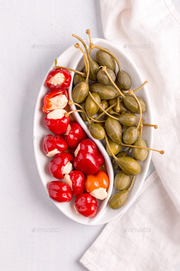 Small peppers and capers above - Stock Photo - Images