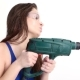 Sexy Girl Drills with a Drill on a White Studio. Concept - Beauty and Strength, Feminism - VideoHive Item for Sale