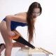 a Sexy Woman in a Blue Swimsuit Sawing Wooden Beams with Saw. the Beautiful Girl Moves Erotically. - VideoHive Item for Sale