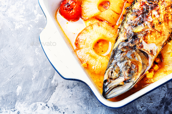 Delicious whole baked fish with pineapple - Stock Photo - Images