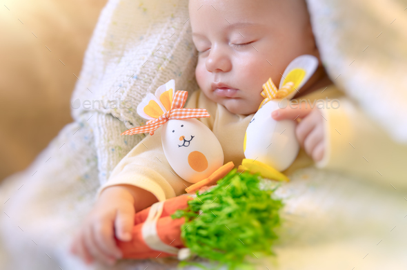 Cute baby sleeping with Easter decorations - Stock Photo - Images