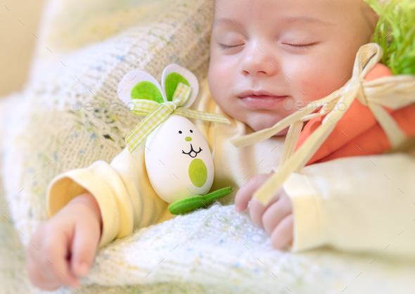 Baby boy with Easter bunny - Stock Photo - Images