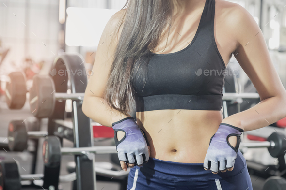 Fitness woman focus on the belly show. - Stock Photo - Images