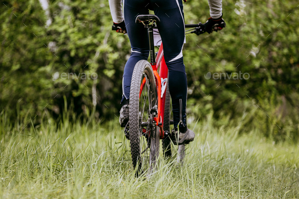 back woman cyclist - Stock Photo - Images