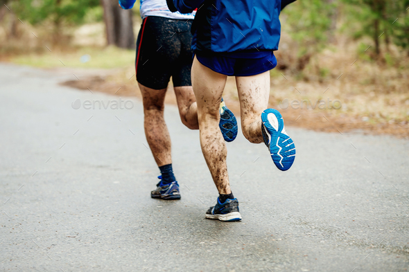 two runners with dirty feet - Stock Photo - Images