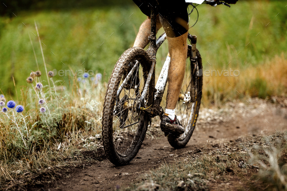 athlete cyclist dirty mountain bike - Stock Photo - Images