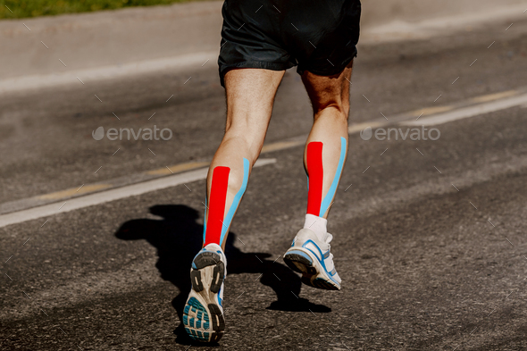 legs runner with kinesio tape - Stock Photo - Images