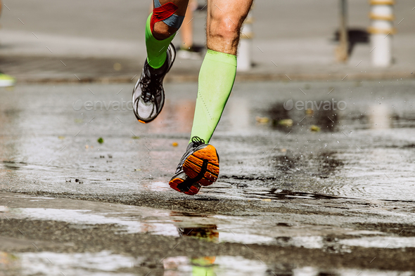 feet runner in compression socks - Stock Photo - Images