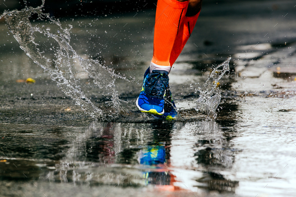 athlete runner run on puddle - Stock Photo - Images