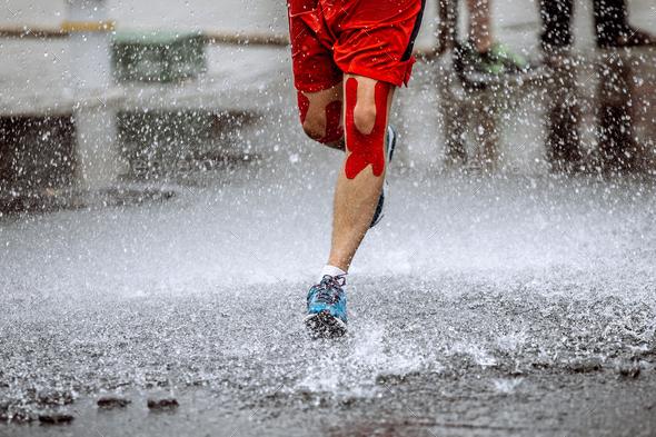 athlete runner knee kinesio tape - Stock Photo - Images