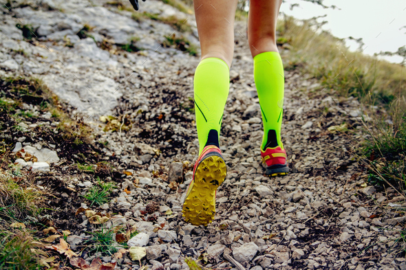 legs female runner in yellow compression socks  - Stock Photo - Images