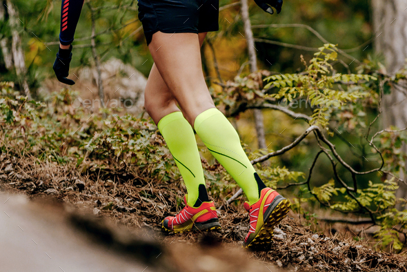 female runner in yellow compression socks - Stock Photo - Images