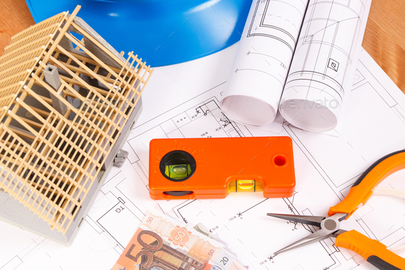 Electrical diagrams, work tools for engineer jobs, house under construction and currencies euro - Stock Photo - Images