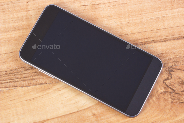 Mobile phone with blank screen on table, using smartphone concept - Stock Photo - Images