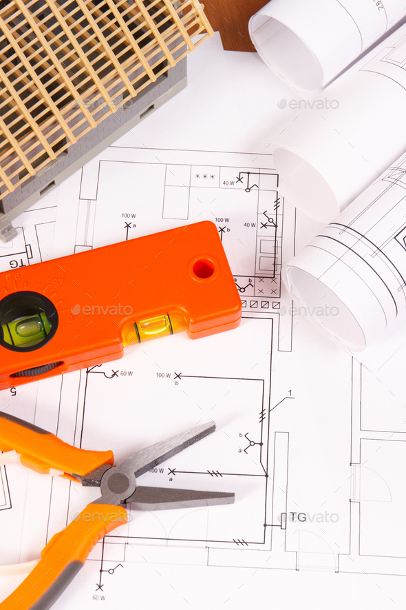 Electrical diagrams or drawings, work tools and house under construction, building home concept - Stock Photo - Images