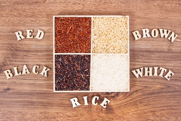 White, brown, black and red rice with inscription on board, healthy gluten free food concept - Stock Photo - Images