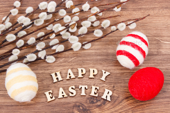 Colorful eggs and Easter catkins as festive decoration - Stock Photo - Images