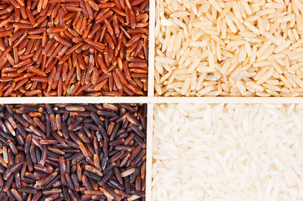 Heap of white, brown, red and black rice, healthy nutrition concept - Stock Photo - Images