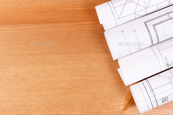 Rolls of electrical blueprints for engineer jobs, copy space for text on board - Stock Photo - Images