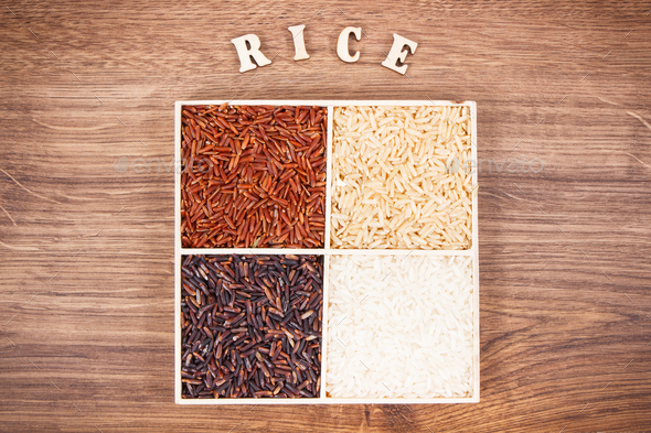 Heap of white, brown, red and black rice with inscription, healthy nutrition concept - Stock Photo - Images