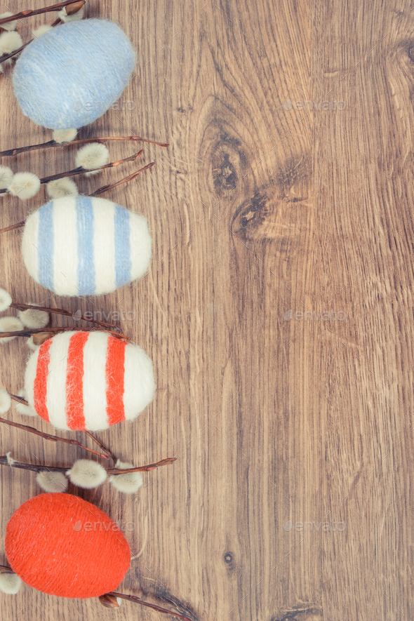 Easter catkins and eggs wrapped woolen string - Stock Photo - Images