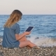 Blonde Woman Reading E-book By Tablet, on Beach in Evening Time - VideoHive Item for Sale